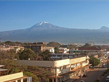 Explore Moshi town, shopping, markets and arts gallery visit.